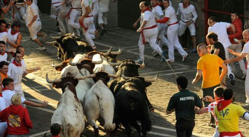 Runners sprint in front of Valdefresno fighting bulls on Santo Domingo hill during the third running of the bulls of the San Fermin festival in Pamplona. Two runners were treated in hospital for bruising after the 2m 27s run. Photograph: Eloy Alonso/Reuters