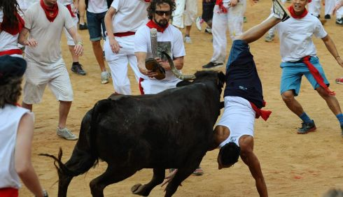 A feat of gymnastics truly worthy of the ancient bull running festival. Photograph: Eloy Alonso/Reuters