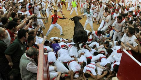 That has got to hurt: a bull leaps over runners on entering the bull ring at Pamplona. Some of those hooves must have made firm contact. Photograph: Eloy Alonso/Reuters
