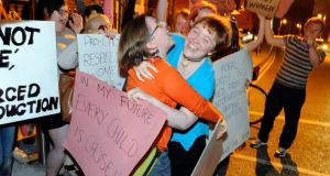 Pro-choice campaigners celebrate as news of the voting in Leinster House comes through. Photograph: Dave Meehan