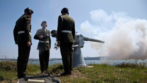 The 1st Brigade Artillary Regiment make a 21-gun salute to mark the occasion of the 75th anniversary of the evacuation and handing over of Spike Island and Cork harbour by the British government to the Irish State. Photograph: Clare Keogh