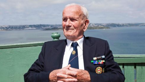 Michael Kelly, retired sergeant in the Irish Army, in his garden overlooking Spike Island, Cork Harbour, Crosshaven, Co Cork, at the anniversary of its handing over to the Irish State. Photograph: Clare Keogh