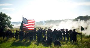 Participants play the role of Union troops during a battle of the wheat field re-enactment for the Battle of Gettysburg's 150th anniversary in Gettysburg, Pennsylvania on July 5th. Photograph: Mark Makela/The New York Times
