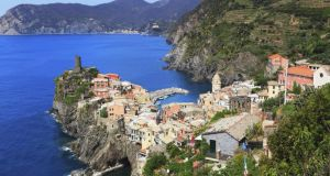 In 2011 a violent rain storm caused landslips that buried the main street and piazza of Vernazza (above) and killed three people. Photograph: IStockphoto