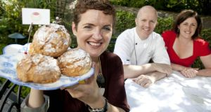 Paula Dwan with her cafe's winning pear and almond scones. In the background are Merrion Hotel executive pastry chef Paul Kelly and Roisin O'Shea, marketing manager, Goodall's