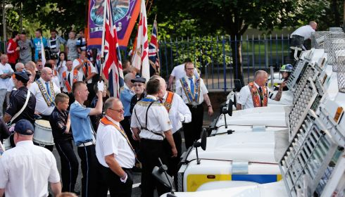 PSNI vehicles stop an Orange Order parade from passing shops in the nationalist Ardoyne area in Belfast on the Twelfth of July. Photograph: Julien Behal/PA Wire