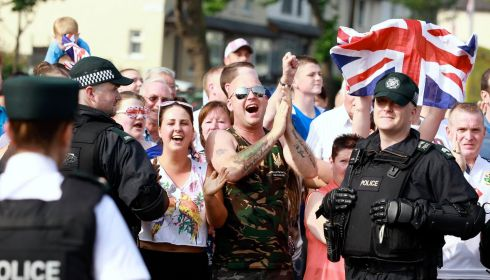 Loyalist supporters cheer as the Orange Order parade passes.  Photograph: Cathal McNaughton/Reuters