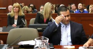 George Zimmerman wipes his face after arriving in the courtroom for closing arguments in his murder trial yesterday in Sanford, Florida. Photograph: Joe Burbank-Pool/Getty Images