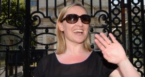 Former minister of state for European affairs Lucinda Creighton waves as she leaves Government Buildings yesterday. She resigned from the Government earlier after voting against it  on the Protection of Life During Pregnancy Bill. Photograph: Brenda Fitzsimons