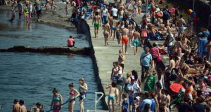 Swimmers cool off at Seapoint, Co Dublin during the heat wave yesterday. Photograph: Cyril Byrne