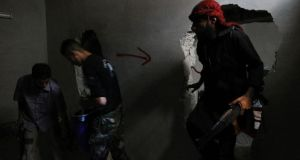 Free Syrian Army fighters take up positions inside a building in Aleppo's Salaheddine neighbourhood yesterday. Photograph:  Reuters/Muzaffar Salman