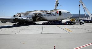 The wrecked fuselage of Asiana Airlines flght 214 sits in a storage area at San Francisco International Airport. Photograph:  Justin Sullivan/Getty Images.
