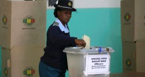 A member of the Zimbabwean police force casts her vote in the capital, Harare today. Photograph: Philimon Bulawayo/Reuters.