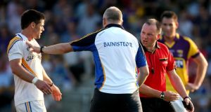 Longford manager Glenn Ryan seperates Shane Mulligan from referee Padrag O'Sullivan. Photograph: Ryan Byrne/Inpho