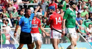 Referee James McGrath sends off Cork's  Patrick Horgan during the Munster SHC Final against Limerick at the Gaelic Grounds. Photograph: James Crombie/Inpho