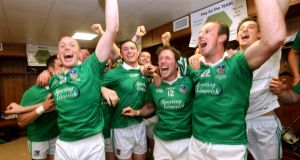 Limerick players celebrate in the dressing room after their victory over Cork. Photograph: James Crombie/Inpho