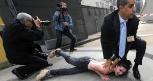 A Femen activist is detained by a security man after staging a protest during a visit by Tunisian prime minister Ali Larayedh near the European Commission in Brussels last month. Photograph: Reuters/Laurent Dubrule