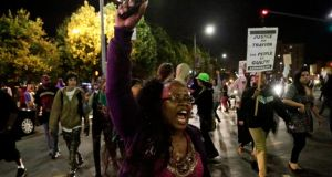 Protesters  march in the Leimert Park area of Los Angeles following the George Zimmerman  acquittal. Photograph: Jason Redmond/Reuters