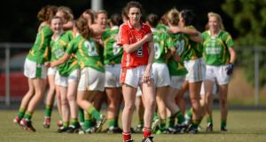 Cork's   Shauna Kelly is left to rue her team's defeat as Kerry celebrate their Munster final win