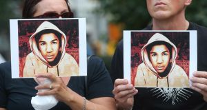 Protesters hold photos of Trayvon Martin at a rally at Union Square in Manhattan, New York City, yesterday. Photograph: Mario Tama/Getty Images
