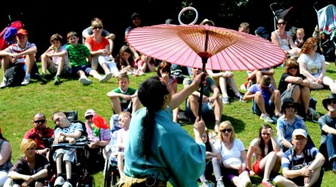 Sun seekers gather to enjoy Tokyo performer Sanmaru's act in Merrion Square. Photograph: Cyril Byrne/The Irish Times