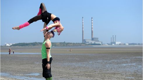 Tarrabelle and Rusty, of Zap Circus, from Australia, rehearse their act on Sandymount Beach, Dublin ahead of the Street Performance World Championship at the weekend at Merrion Square, Dublin. The championship continues this weekend in Cork.  Photograph: Dara Mac Dónaill/The Irish Times