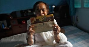 Surjeet Kaur, 77, displays a telegram which was sent by her husband on her birthday in 1955. Photograph: Mansi Thapliyal/Reuters