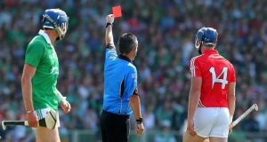 Cork's Patrick Horgan is shown a red card by referee James McGrath after a foul on Paudie O'Brien. Photograph: Lorraine O'Sullivan/Inpho