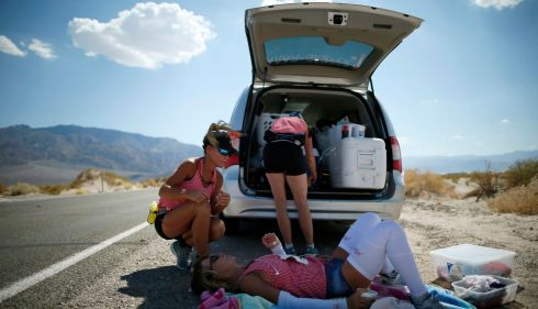 Shannon Farar-Griefer (52), of Hidden Hills, California lies down for a breather with her support team amid the unbelievably tough conditions. It is Death Valley after all. Photograph: Lucy Nicholson/Reuters