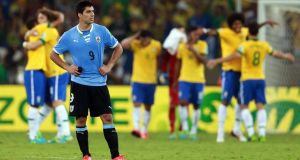 Luis Suarez during Uruguay's Confederations Cup against Brazil last month. Photograph: Scott Heavey/Getty Images
