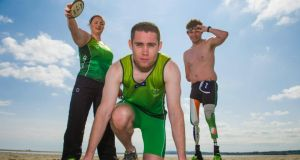Paralympic athletes Jason Smyth with Orla Barry and Darragh McDonald at Sandymount Strand, Dublin. Photograph: Sportsfile