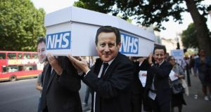Protesters from the 'National Health Action Party' lead a mock funeral procession for the NHS along Whitehall on July 5, 2013 in London. Photograph: Oli Scarff/Getty Images