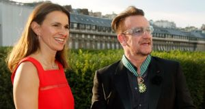 U2 singer Bono with French culture minister Aurelie Filippetti after he was made a Commander of the Order of Arts and Letters in Paris yesterday. Photograph: Reuters/Charles Platiau