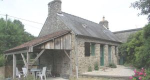 A pretty renovated stone cottage with garden and period features near Gorron, The Loire, France. Accommodation includes a combined kitchen/livingroom with stone walls, beams and a wood-burning stove. Priced at €70,200, with  latitudes.co.uk