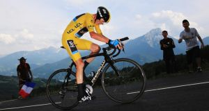 Chris Froome of Great Britain and SKY Procycling on his way to finishing first during stage seventeen of the 2013 Tour de France, a 32KM Individual Time Trial from Embrun to Chorges. Photograph:  Doug Pensinger/Getty Images