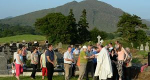 Fr Martin Sheehan distributing Communion at the annual Kilmakilloge pattern Mass. Photograph: Frank Miller