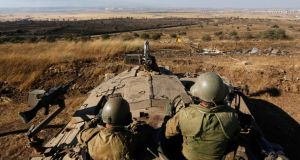 Israeli soldiers sit atop a tank as they patrol near the Quneitra border crossing between Israel and Syria, on the Israeli-occupied Golan Heights. Photograph Reuter/Baz Ratner