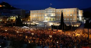 Demonstrators protest in front of the Greek parliament in Athens yesterday.  Photograph: Reuters/Yannis Behrakis