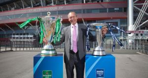 John Griffiths, Welsh  minister for sport and culture, at the Millennium Stadium in Cardiff with the Heineken Cup and Amlin Challenge Cup following yesterday's announcement. Photograph: Huw Evans/Inpho