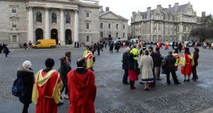 Newly conferred graduates on the  front square at Trinity College Dublin. A small increase in  third-level applicants is expected to mean there will be little impact on  points requirements. Photograph: Frank Miller