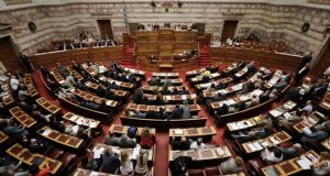 Greece's government secured enough parliamentary votes to pass the bill early today. Photograph: John Kolesidis/Reuters