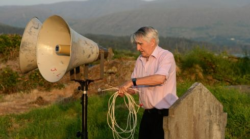 Jerh Lyne sets up the sound sytem for the Pattern Mass at St Kilian's cemetery. Photograph: Frank Miller/The Irish Times