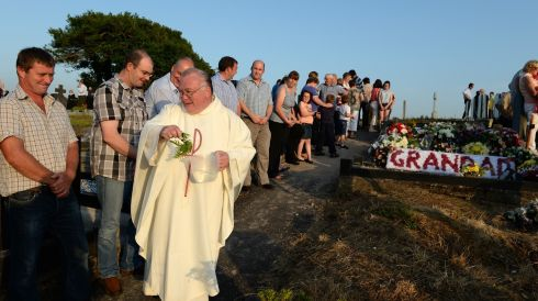 Fr Sheehan blesses graves after the Pattern Mass. Photograph: Frank Miller/The Irish Times
