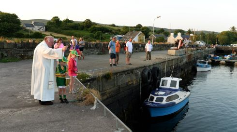 The boats at the adjacent harbour get a blessing too. Photograph: Frank Miller/The Irish Times