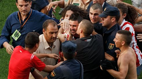 Grown men scramble to kiss Falcao's replacement, former Barcelona striker David Villa, after he was unveiled at Atletico Madrid's Estadio Vicente Calderon. Photograph: Gonzalo Arroyo Moreno/Getty Images