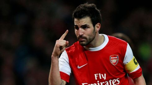 Former Arsenal midfielder Cesc Fabregas has emerged as a target for Manchester United but an initial £26m tester was rebuffed by Barcelona. His former Gunners boss Arsene Wenger has insisted he was intent on staying in Catalonia for another year. Here he is during his Arsenal captainship against none other than Barcelona during a Champions League game in February 2011. Photograph: Eddie Keogh/Reuters