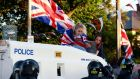 Loyalist protesters climb on an armoured police vehicle in the Woodvale Road area of north Belfast last  Sunday. Photograph: Cathal McNaughton/Reuters