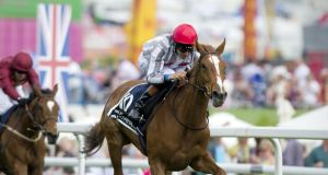Jockey Richard Hughes rides Talent to victory in The Oaks at  Epsom