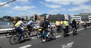 People take part in a Bike to Work Lunchtime Cycle in Dublin city centre last month. Photographer: Dara Mac Dónaill/The Irish Times