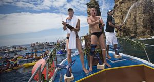 (Left to  to right) Gary Hunt of  Britain, Artem Silchenko of Russia and Orlando Duque of Colombia celebrate during the third stop of the Red Bull Cliff Diving World Series in the Azores